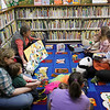 Record-Eagle/Jan-Michael Stump<br /> Assistant librarian Sharon Siladke leads Friday's Baby Play Time at the Interlochen Library.