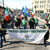 Record-Eagle/Keith King<br /> Leon Kiley, right, and his brother, Evan Kiley, both of Traverse City, carry a banner ahead of their fellow members of the Ancient Order of Hibernians, Bernard J. Bun Brady Division, on Saturday during the St. Patrick's Day Parade in downtown Traverse City.