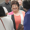 Record-Eagle/Jan-Michael Stump<br /> Helen Cook is greeted by friends after receiving the Sara Hardy Humanitarian Award at Monday's City Commission meeting.