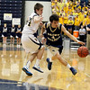 Record-Eagle/Jan-Michael Stump<br /> Traverse City St. Francis' Ian Spencer (4) tries to drive past Negaunee's Eric Lori (34) in Tuesday's state quarterfinal game in Petoskey.