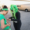 Record-Eagle/Keith King<br /> Angelina Baker, left, and Aly Jarosz, both of Traverse City, prepare for the Leapin' Leprechaun 5k race on Saturday  in Traverse City