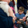 "Record-Eagle/Jan-Michael Stump<br /> Drew Harrall, 7, holds a rabbit during Saturday's 4-H Spring Expo at Suttons Bay High School. ""He said, 'After our dogs die, can we get some bunnies?'"" said Kim Harrall, Drew's mother."