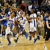 Record-Eagle/Jan-Michael Stump<br /> Southfield Christian players celebrate their 76-44 win over Climax-Scotts in Saturday's Class D state finals in East Lansing.