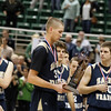 Record-Eagle/Jan-Michael Stump<br /> Sean Sheldon accepts TC St. Francis' state finalist trophy Saturday.