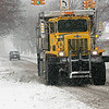 Record-Eagle/Douglas Tesner<br /> A Traverse City snow plow works its way through town as it cleans up the roads.