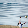 Record-Eagle/Jan-Michael Stump<br /> Elise Campbell, 17, of Traverse City, practices her volleyball skills with Josh Niewiadomski, 23, (not pictured) on West End Beach near a still partially-frozen West Arm of Grand Traverse Bay on Monday afternoon.