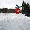 Record-Eagle/Keith King<br /> A stop sign in Solon Township is surrounded by snow at the intersection of South Cedar Road and East Alpine Road on Tuesday.