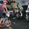 Record-Eagle/Jodee Taylor<br /> Rhonda Brandt, in pink cap, leads a spinning class at Fitness Factor. Every other Saturday, the class benefits a local charity.