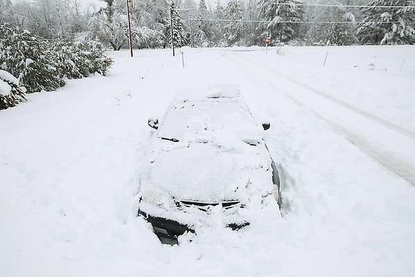 Record-Eagle/Keith King<br /> Snow surrounds a vehicle parked Saturday on South Timberlee Drive near East Fouch Road in Elmwood Township.