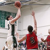 Record-Eagle/Keith King<br /> Boyne Falls' Josh Puroll shoots the ball against Bellaire's Kasey Poel (5) and Mitch Teetzel (30) Friday, March 9, 2012 at Boyne Falls Public School.