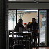 Record-Eagle/Jan-Michael Stump<br /> Rick Ross, left, and Zach White have a beer at The Filling Station microbrewery, which opened for business Tuesday afternoon in Traverse City's old railroad depot.