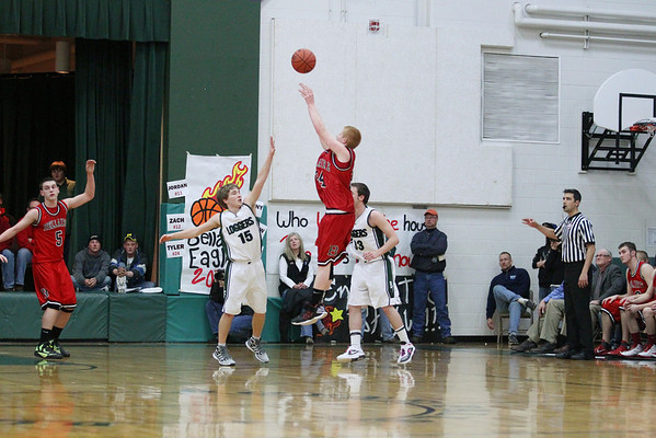 Record-Eagle/Keith King<br /> Bellaire's Tyler Thornton unleashes a shot in the third quarter.