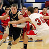 Record-Eagle/Jan-Michael Stump<br /> Traverse City St. Francis' Byron Bullough (21) drives past Suttons Bay's Aaron Orban (30) in the first quarter of Wednesday's game.