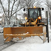 Record-eagle/Vanessa McCray<br /> <br /> An Elmer's plow clears snow and slush from the front of Central Grade School in Traverse City Wednesday morning. The leap-year day brought a snow day for local students.