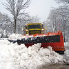 Record-Eagle/Loraine Anderson<br /> A city snowplow truck stops at the corner of Randolph and Monroe on Saturday morning so that the driver can get out to check a downed wire.