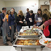 Record-Eagle/Jan-Michael Stump<br /> Elk Rapids High School faculty make their way through the lunch line for a meal made by students in the school's lifeskills class on Friday.