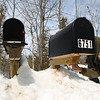 Record-Eagle/Keith King<br /> Doug Dubay, of Solon Township, applies a temporary fix Tuesday to his mailbox that was damaged Saturday, likely by heavy snow from a snowplow truck.