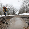 Record-Eagle/Keith King<br /> Robin Talsma, with the Benzie County Road Commission, puts base into a large pothole, caused by the recent freezing, thawing and rain, prior to putting asphalt into it Thursday, March 8, 2012 along County Highway 610 in Almira Township.