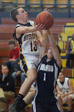 Record-Eagle/Jan-Michael Stump<br /> Northport's Bill Stowe (13) drives over Grand Traverse Academy's Timothy Fraser (1) in the third quarter of Monday's game.