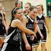 Record-Eagle/Jan-Michael Stump<br /> Leland's Hanna Schaub, center, hugs Caitlin McKee after beating Manistee Catholic Central 50-43 in Tuesday's Class D regional semifinal at TC West.
