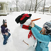 Record-Eagle/Keith King<br /> Tess Crowley, right, 10, of Traverse City, and her sister, Natalie Crowley, 7, make a snow creature practically come alive.