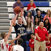 Record-Eagle/Jan-Michael Stump<br /> Traverse City St. Francis' Sean Sheldon (31) shoots over Suttons Bay's Guy Beachnau (14) and Aaron Orban (30) in the first half of Wednesday's game.