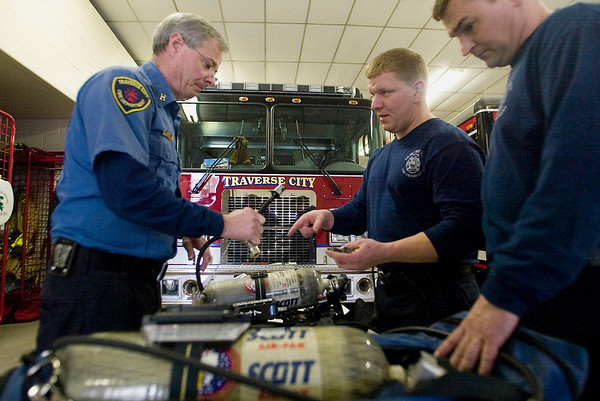 Record-Eagle/Jan-Michael Stump<br /> Traverse City Fire and Rescue Captain Bill Tomlinson, left, and firefighters Tom Thompson, center, and Chad Rueckert go through Rapid Intervention Team training at Station 1.