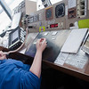 Record-Eagle/Douglas Tesner<br /> Air Traffic Controller Justina Godsell works with antiquated equipment as she directs an  aircraft at Cherry Capital Airport. $11.2 million has been earmarked to replace the airport's 35-year-old air traffic control tower.