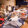 """Record-Eagle/Douglas Tesner<br /> Rebecca and Jonathan Reed, left, shop for clothing for their unborn son at St. Francis High School's """"Big Knick Knack Give-Back Garage Sale."""" Rebecca is due in September. St. Francis High School is helping homeless teens in the Traverse City Area through the sale, a community-wide garage sale that the school plans to make an annual event with different beneficiaries each year. This year's proceeds will go to the Host Homes for Homeless Youth Program."""