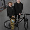 Record-Eagle/Keith King<br /> Brothers Dakota Porter, right, 16, and Garret Porter, 13, developed an LED lighting kit called Action Glow which is attached to their bicycle and long board. Here they stand with the lighting kit in Traverse City.