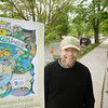 Record-Eagle/Keith King<br /> Paul Skinner, organizer of the Empire Asparagus Festival, stands Thursday, May 17, near a poster that was designed by Tim Lewis, of Empire, for this year's festival. The design also appears on the shirts for this year's festival, which is scheduled for Friday, May 18, through Sunday, May 20.
