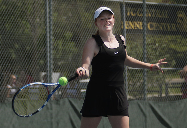 Record-Eagle/Keith King<br /> Traverse City Central's Paige Cooley competes at No. 1 singles Tuesday at Traverse City Central High School. Cooley was the flight champion, netting a 3-0 record.