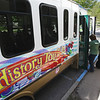 Record-Eagle/Keith King<br /> A group preparing to take the Magical History Tour boards the bus at the History Center of Traverse City.