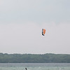 Record-Eagle/Jan-Michael Stump<br /> Kiteboarder and windsurfers take advantage of a windy Tuesday afternoon in East Grand Traverse Bay off Bayside Park in Acme.