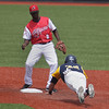 Record-Eagle/Keith King<br /> The Traverse City Beach Bums' Jon Hurst slides safely into second base against London Rippers' Justino Cuevas on Saturday at Wuerfel Park.