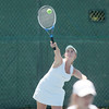 Record-Eagle/Jan-Michael Stump<br /> Traverse City St. Francis' Sarah Stayman serves as she and Courtney McCardel face Harbor Springs' Liza Wilkes and Rae Claramunt at No. 4 doubles in Thursday's tennis regionals at Traverse City Central.
