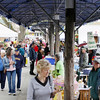 Record-Eagle/Keith King<br /> Vendors and shoppers gather Saturday during the Sara Hardy Downtown Farmer's Market.