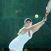 Record-Eagle/Jan-Michael Stump<br /> Traverse City St. Francis' Bailey Rae volleys against Charlevoix's Lexi Barnes at N. 4 singles in Thursday's tennis regionals at Traverse City Central.