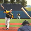 Record-Eagle/Keith King<br /> The Traverse City Beach Bums' Michael Cotter pitches against the London Rippers Saturday during an exhibition game at Wuerfel Park.