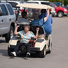 Record-Eagle/Jan-Michael Stump<br /> Mary Skarnulis, of Rapid City, rides on the back of a  golf cart to the Senior Expo.