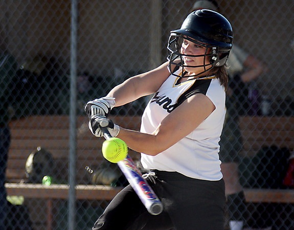 Record-Eagle/ Keith King<br /> TC Central's Nikki Schaub connects against TC West in a Big North Conference softball game Tuesday.