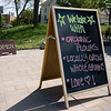 Record-Eagle/ Keith King<br /> A sandwich board sign is displayed Thursday in front of Pleasanton Brick Oven Bakery at the Grand Traverse Commons in Traverse City.