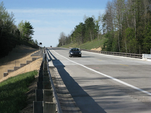 Record-Eagle/Jodee Taylor<br /> A car travels across the newly reopened bridge on U.S. 131 across the Manistee River.