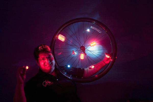 Record-Eagle/Jan-Michael Stump<br /> Kris McLain, of McLain Cycle and Fitness, is helping with a safety initiative sponsored by an anonymous donor to provide blinking red lights to walkers and cyclists at night. The lights will be distributed by Traverse City police.