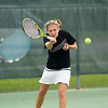 Record-Eagle/Jan-Michael Stump<br /> Harbor Springs' Anna Asbury volleys while playing No. 1 doubles with Emily Skau against Traverse City St. Francis' Elizabeth Stayman and Abby Shrift.