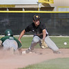 Record-Eagle/ Keith King<br /> Traverse City Central's Zac Zoellner prepares to catch the ball as Traverse City West's Kevin Kreta dives back into second base Tuesday.