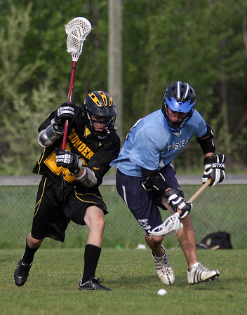 Record-Eagle/ Keith King<br /> Traverse City Thunder defender Stuart Stevenson, left, battles Petoskey's Ken Forton for the ball Thursday in a lacrosse game at the Carlisle Road field in Traverse City.
