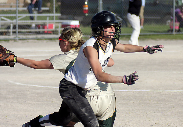 Record-Eagle/ Keith King<br /> TC Central's Adrienne Bruder beats a throw to first.