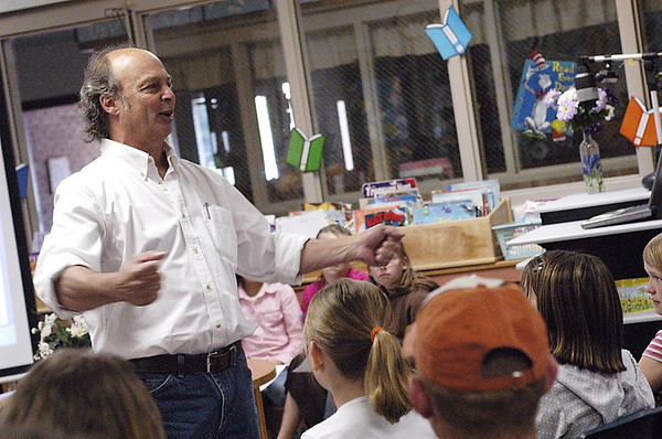 """Record-Eagle/Lisa Perkins<br /> Poet Terry Wooten spoke to students and parents at Silver Lake Elementary School last week culminating days of poetry workshops with third-, fourth- and fifth-graders. Wooten, along with the young aspiring poets, recited their work filled with the """"power words"""" that Wooten talked about to replace """"nerd words."""""""
