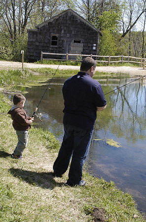 Record-Eagle/Lisa Perkins<br /> Phil Detloff and his three-year-old son Joseph spent Saturday afternoon fishing in the recently reconstructed pond at Kid's Creek Park in Garfield Township. The DNRE has agreed to stock the pond, located on the former Oleson Buffalo Farm, with adult brown trout and bluegill. Kid's Creek Park is a permanent open space and natural resource preservation and includes nearly a mile of unpaved walking path near Great Wolf Lodge.
